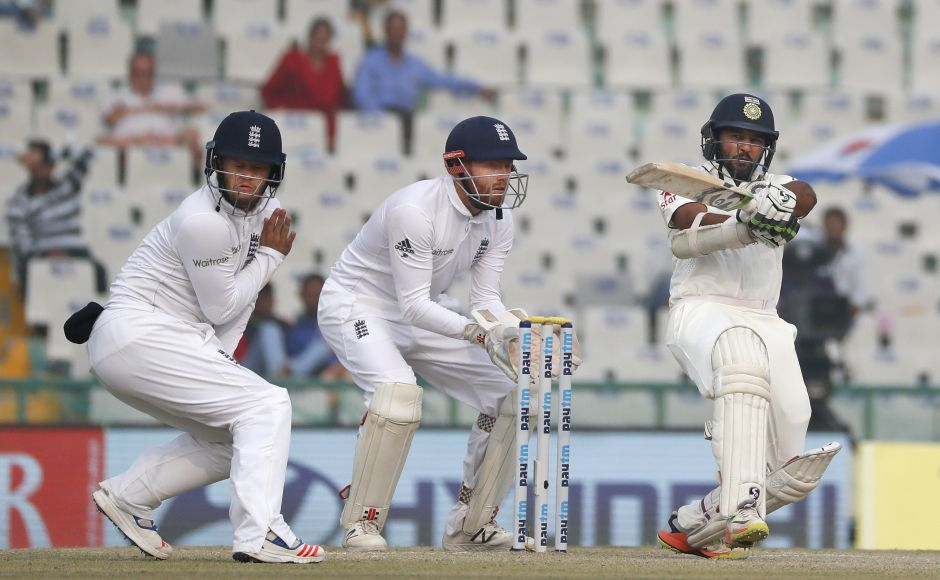 India's Parthiv Patel plays a shot for a boundary on the fourth day of the third cricket test match against England, in Mohali, India, Tuesday, Nov. 29, 2016. (AP Photo/Altaf Qadri)