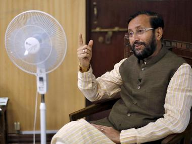 India's Environment Minister Prakash Javadekar speaks on his phone before an interview with Reuters inside his office in New Delhi, India, September 21, 2015. REUTERS/Adnan Abidi/File Photo