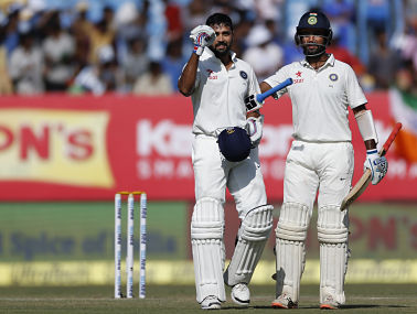 Murali Vijay, left, celebrates after scoring a century, with Cheteshwar Pujara, on day 3. AP