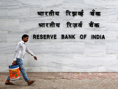 A man walks past the Reserve Bank of India (RBI) head office in Mumbai, India, June 7, 2016. REUTERS/Danish Siddiqui/File Photo - RTX2HW1V