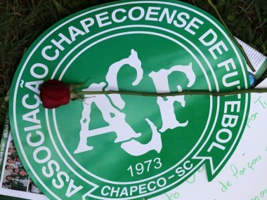 A flower is pictured over a Chapecoense team logo in tribute to their players. Reuters