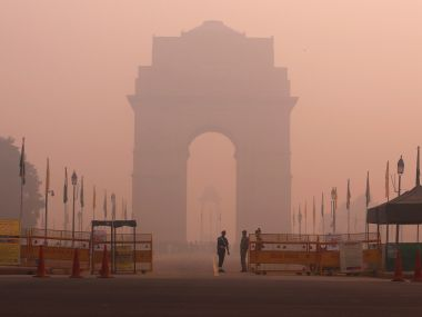 Security personnel stand guard in front of the India Gate amidst the heavy smog in New Delhi. Reuters