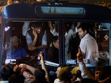 New Delhi: Congress party Vice President Rahul Gandhi being carried in a police bus from Parliament Street Police Station in New Delhi on Wednesday. Gandhi was earlier detained after he tried to meet family members of a retired army soldier who allegedly committed suicide over One Rank, One Pension scheme. PTI Photo by Manvender Vashist (PTI11_2_2016_000276B)