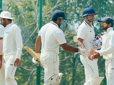 Delhi and Rajasthan players greet each other following Delhi''s victory in the Ranji Trophy tie. PTI