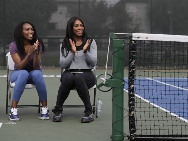 Venus Williams and sister Serena during a dedication ceremony of the Lueders Park tennis courts. AP