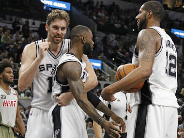 San Antonio Spurs players celebrating. AP