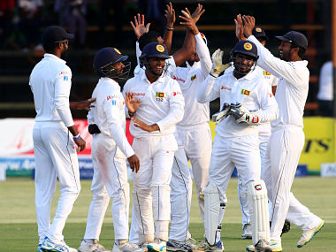 Sri Lanka's players celebrate their victory against Zimbabwe in 1st Test. AFP