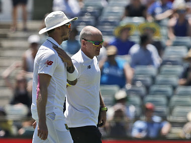 Dale Steyn holds his shoulder as he walks off the field on day 2 of the Perth Test. AP
