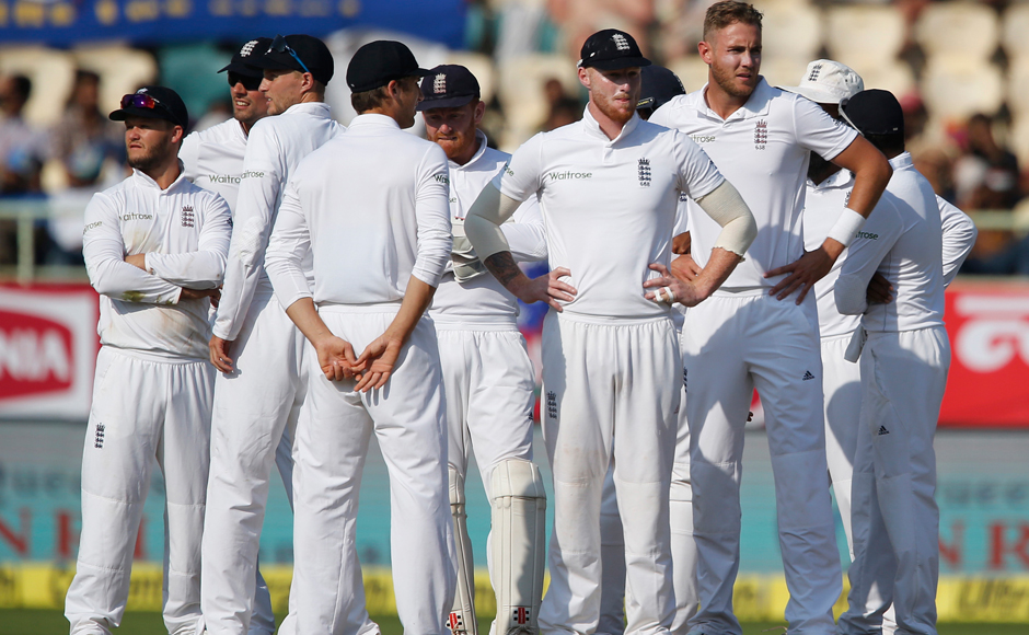 Stuart-Broad-and-team-mates-wait-for-the-third-umpire's-decision-on-Murali-Vijay's-lbw.-It-was-eventually-ruled-in-their-favour,-their-first-successful-referral-in-the-ongoing-series-AP