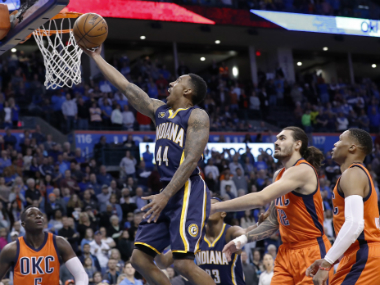 Indiana Pacers' Jeff Teague (C) scores against the Oklahoma City Thunder. AP