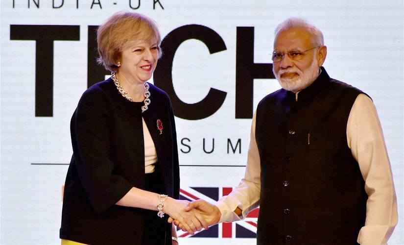 Prime Minister Narendra Modi shakes hands with UK counterpart Theresa May at the inauguration of India- UK Tech Summit. PTI