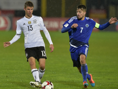 Thomas Müller (L) in the match against San Marino. AP