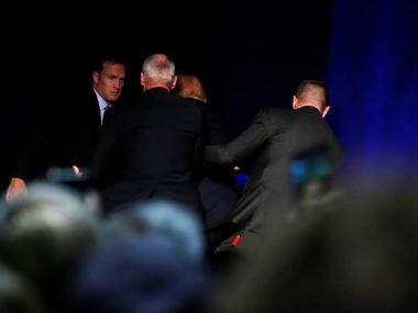 Republican presidential nominee Donald Trump is hustled off the stage by security agents following a perceived threat in the crowd at a campaign rally in Reno. Reuers