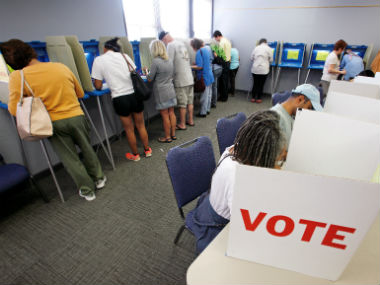 People cast their ballots for the US election at a crowded polling station as early voting begins in North Carolina. Reuters