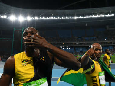 Usain Bolt (L) and Asafa Powell (R). AFP