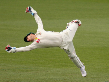 Australia wicket-keeper Matthew Wade dives to take a catch. Getty images