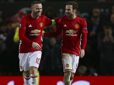 Wayne Rooney and Juan Mata celebrate his goal. AP