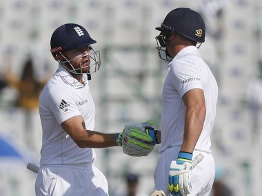 England's Jonathan Bairsto is greeted by his teammate Jos Buttler after he scored half century. AP