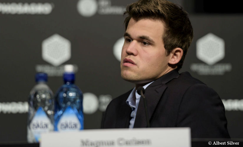 A dejected Carlsen after his first defeat in the ongoing World Championships. Image courtesy: Albert Silver.
