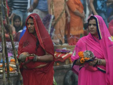 Devotees worshiping on the occasion of the Chatt festival at Boat Club in New Delhi on Sunday. PTI