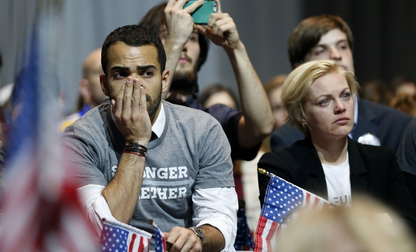 Hillary Clinton supporters react as results come in at an election night party for the Democratic presidential candidate at the Jacob K. Javits Convention Center in New York. AP