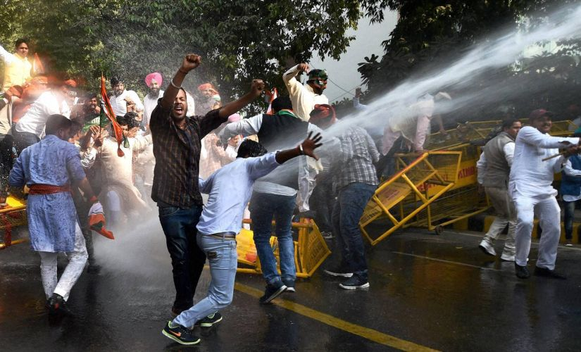 Security personnel use water cannon on Youth Congress activists during a protest against demonetisation in New Delhi on Friday. PTI