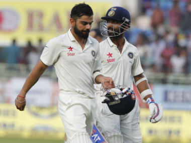 Kohli and Rahane walk back after taking India to a comfortable position at the end of Day 3. AP
