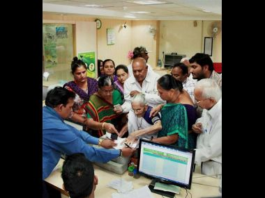 Heeraben, Prime Minister Narendra Modi's mother, at a bank on Tuesday. PTI