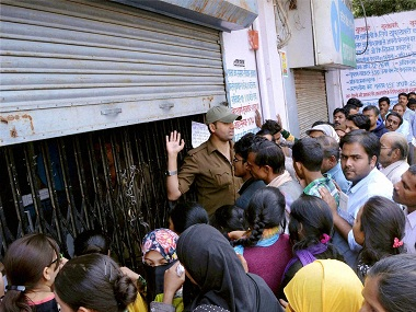 Allahabad: People stand in long queues to deposit or exchange their old notes outside a bank in Allahabad on Thursday. PTI Photo (PTI11_17_2016_000229B)