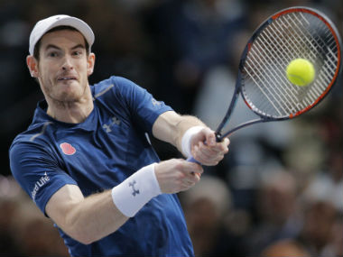 Andy Murray returns to John Isner during the final of the Paris Masters. AP