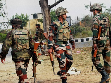 Army personnel take position during the encounter after militants attacked an army camp in Nagrota on the outskirts of Jammu on Tuesday morning. PTI