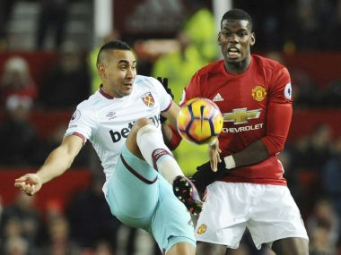 West Ham's Dimitri Payet and Manchester United's Paul Pogba fight for the ball. AP