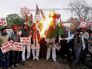 Samajwadi Party workers take part in protests on Monday. PTI