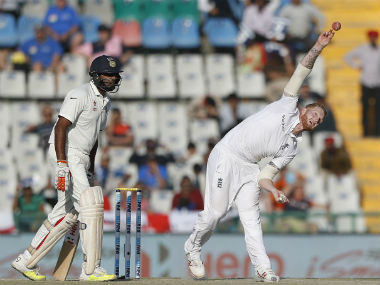 England's Ben Stokes bowls on Day 2 of the 3rd Test against India in Mohali. AP