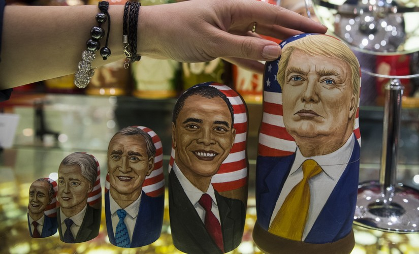 Traditional Russian wooden dolls called Matreska depict US presidents, from left, George H.W. Bush, Bill Clinton, George W. Bush, Barack Obama and US presidential candidate Donald Trump displayed in a shop in Moscow, Russia on Tuesday, Nov. 8, 2016. Tens of millions of voters across the United States will now decide on the next occupant of the White House as polling stations open across the country. (AP Photo/Pavel Golovkin)