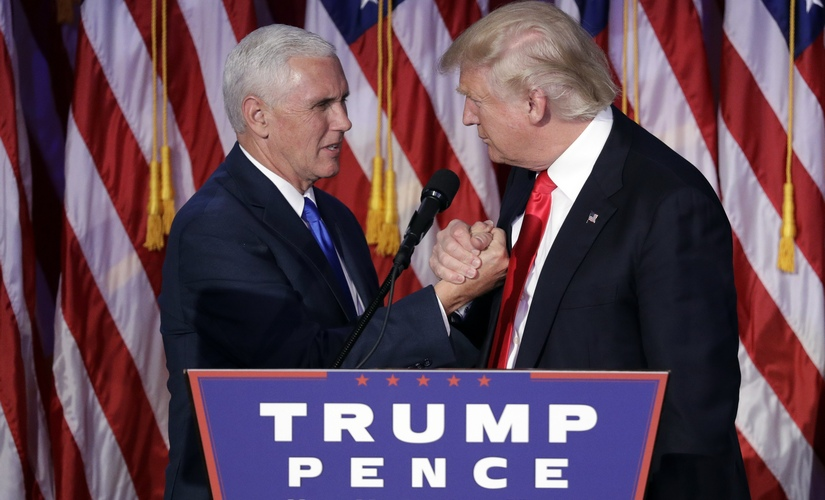 Donald Trump and Mike Pence shake hands after the result. AP