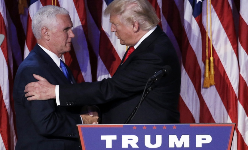 US President-elect Donald Trump greets his running mate Mike Pence. Reuters