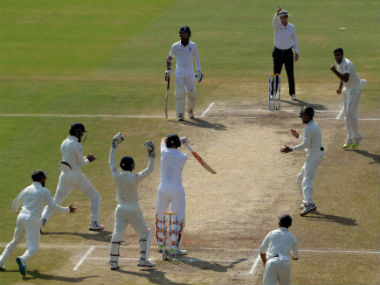 Indian players celebrate the wicket of England's Joe Root in the second Test at Vizag. AFP