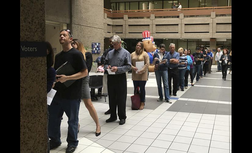 The line of voters waiting outside a building in San Jose. AP