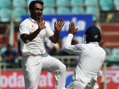 Jayant Yadav (L) celebrates the wicket of England's Ben Stokes in the 2nd Test agaisnt England at Vizag. AFP