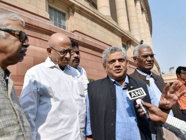 CPM general secretary Sitaram Yechury along with other leaders outside Parliament in New Delhi on Thursday. PTI