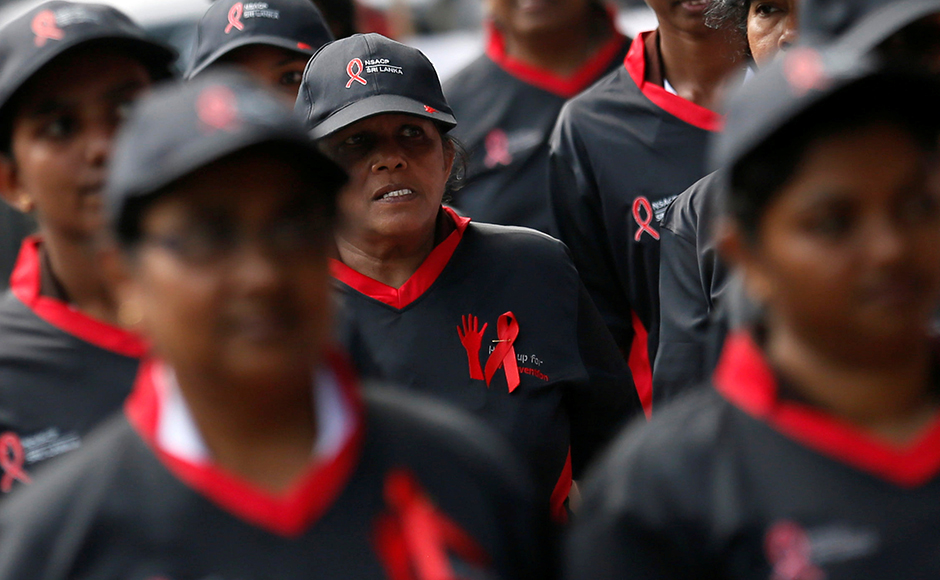 A group of women march during an event to mark the World AIDS day in Colombo, Sri Lanka December 1, 2016. REUTERS