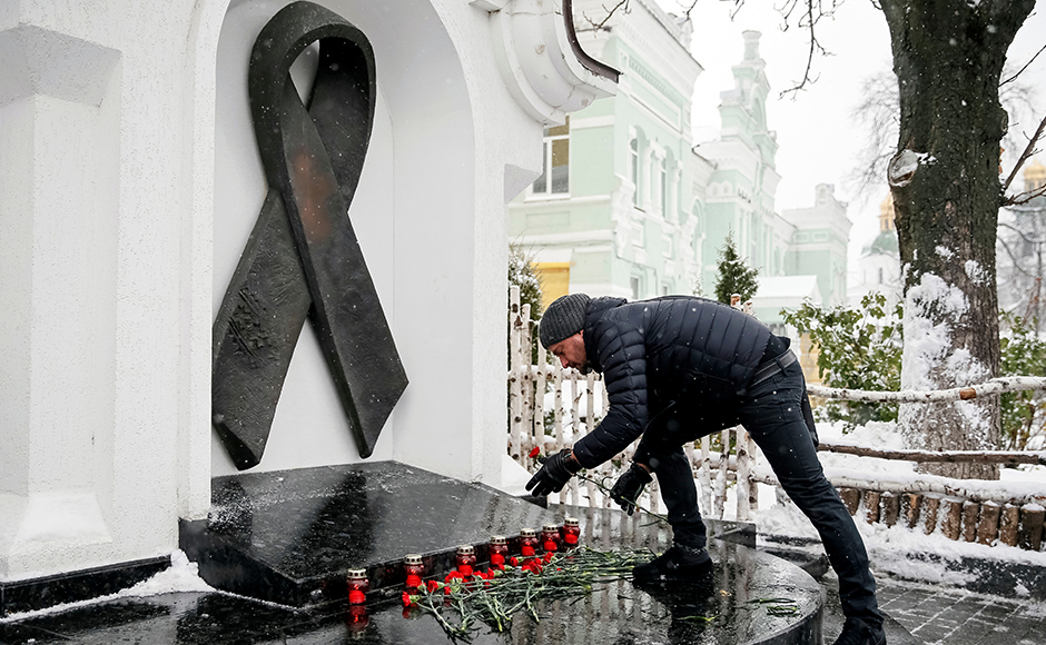 A participant lays flowers as he takes part in a ceremony to mark World AIDS Day near a monument in memory of AIDS victims in Kiev, Ukraine December 1, 2016. REUTERS