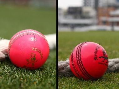 Pink ball with white and green seam used before (L) and with black seam used now. Getty Images