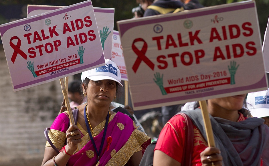 Indian health workers, volunteers and students take out a health awareness procession to mark theWorld AIDS Day in Hyderabad, India, Thursday, Dec. 1, 2016. World AIDS Day is observed every year to raise people's awareness in the fight against HIV. (AP Photo/Mahesh Kumar A. )