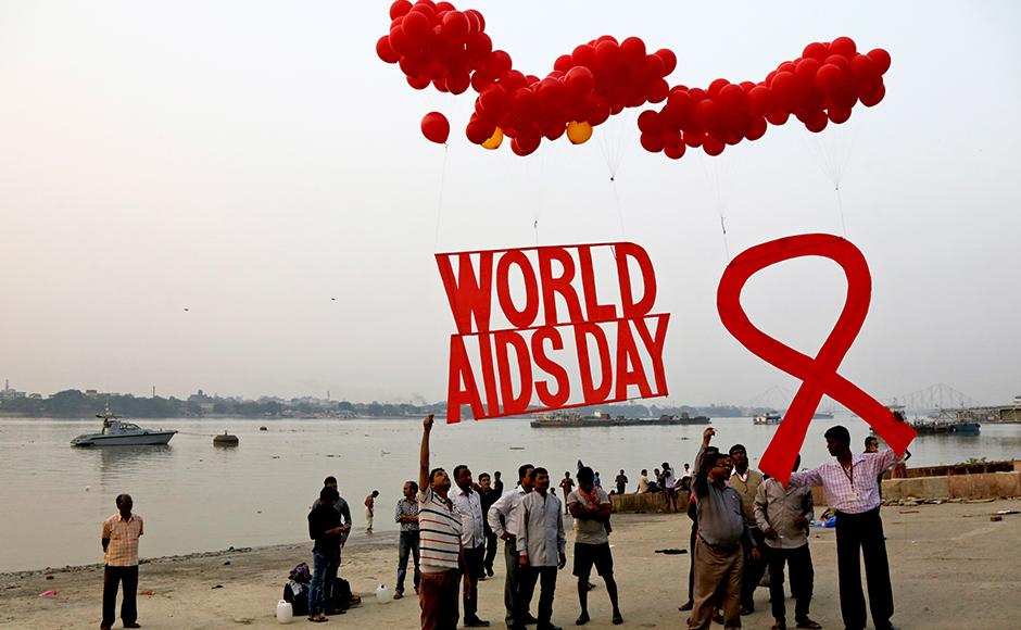 Activists prepare to release campaign materials into the air ahed of WorldAIDSDay on the banks of the Ganges River in Kolkata, India, Wednesday, Nov. 30, 2016. WorldAIDSDay is celebrated on Dec. 1 every year to raise awareness about HIV/AIDS and to demonstrate international solidarity in the face of the pandemic. (AP Photo/Bikas Das)