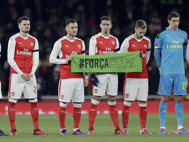 Arsenal players including Gabriel players holding banner, from Brazil lineup for a minute's silence in memory of the members of the Brazilian soccer team Chapecoense who died in a plane crash, prior to the English League Cup quarterfinal against Southampton. AP