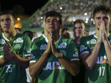 Chapecoense fans mourn the deaths of the victims of the plane crash. AP
