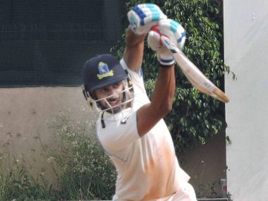Bengal captain Manoj Tiwary plays a shot during Ranji Trophy match against Mumbai. PTI