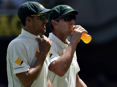 File photo of Mitchell Starc (L) and Josh Hazlewood. AFP